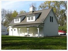 nice detached garage or shop or studio or apartment. Love the carriage house look.