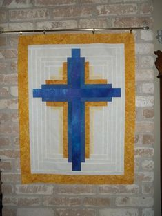 Looking for quilting project inspiration? Check out log cabin cross wallhanging by member carolyn rae.