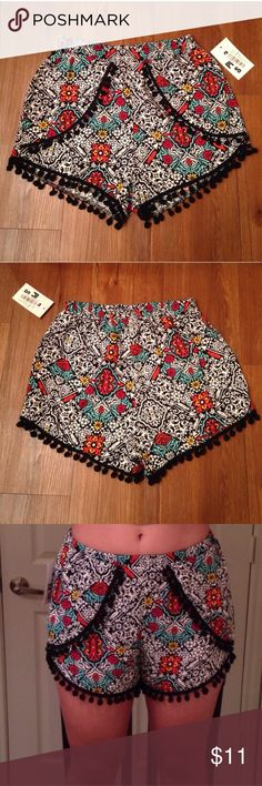 Patterned pom pom shorts Brand new, tag removed though, purchased from Dilliards. Size small. Material 100% rayon. Elastic band around waist. I wear a size 4 and i am modeling im the pic. I would say it can fit a size 2 or 4. Copper Key Shorts