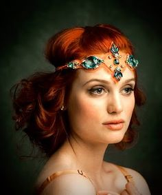 Love her hair color and the head piece. She's stunning all-way round.