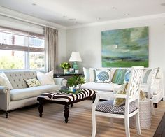 Pay attention to the white couch in the back, notice how they picked up the colors from the paint and incorporated them om the throw cushions and a few accesories. There is no doubt that the focal point here is the painting on the wall, followed by the bold coffee table.