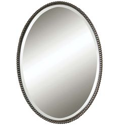 Pair thisBeaded Oval Mirror with Beveled Glass with rod iron sconces and it would look fantastic
