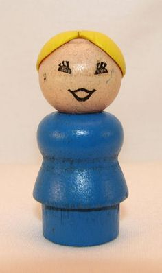 Wooden Fisher Price people.