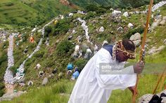 Thousands of followers of the Nazareth Baptist Church also known as the 'Shembe Church' climb the Nhlangakazi Mountains at Ndwedwe, north of Durban, 08 January 2005. The devotees climbed the mountain to attend the first sermon at he Nhlangakazi Mountains as part of their annual pilgrimage. The church was founded in 1913 and is one of the largest African traditonalist churches in Africa. The pilgrims walk up to 80 kilometers barefoot, worshipping and camping on their holy walk to the… Pilgrims, Barefoot, Holi, Worship, Followers, January, Religion, African, Camping