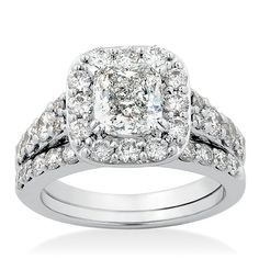 Two piece  wedding set in 14K white gold with 1.46 carat cushion cut diamond. Additional diamonds equal 1 and 1/2 carat total weight.