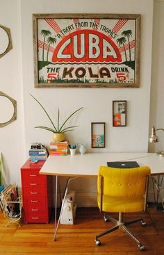 love the red file cabinet, yellow chair, and vintage poster.  It all works together so well!