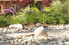 Create a beautiful and low maintenance garden incorporating river rock; landscaping with a dry stream and using river rock to accent your garden. River Rock Landscaping, Landscaping With Rocks, Backyard Landscaping, Landscaping Ideas, Backyard Ideas, Patio Ideas, Backyard Layout, Luxury Landscaping, Rustic Backyard