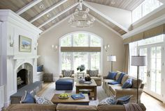 Great ceiling - love the clearstory windows, french doors w/ transoms, window w/ arched extension - lets in so much light. Love furniture arrangement here also as you can really watch TV but still talk w/ o feeling like you're in an AV room.  By Celia Welch Interiors *this website has lots of great interior design pic's that could be useful to show to a designer b/f they come so we have lots of ideas to show