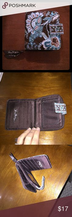 Vera Bradley small wallet This is a gently used in very good condition Vera Bradley wallet. So cute with the pattern, the colors and the size is perfect for many purses! Vera Bradley Bags Wallets