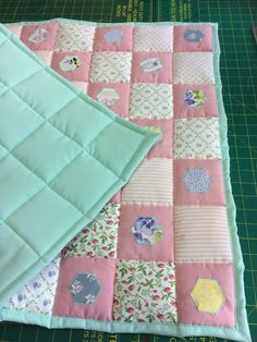 A personal favourite from my Etsy shop https://www.etsy.com/uk/listing/484449275/quilted-baby-blanket-baby-shower-gift