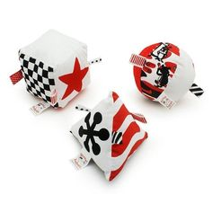 Infant Graphic-Shapes Set by Genius Baby Toys. $17.95. Infant Graphic-Shapes Block Set of 3, by Genius Baby Toys - includes three large, soft shapes, in high contrast black, white and red. Shapes may be used together or individually. Each shape features multiple textures and an individual sound...one has a crinkle noise, one a rattle and one a bell sound. This wonderful, research correct set helps develop baby's visual activity and gross motor skills.  Birth and up.