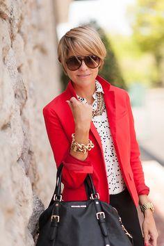 Red blazer, chunky jewellery, black pants, polka dot shirt