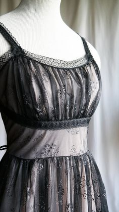 A unique addition to any boudoir, this nightgown has a layer of black sheer nylon with glittered blossoms over a layer of soft pink champagne