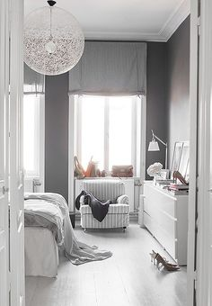 "Gray walls add depth and contrast to this all-white room, while bold light fixtures make it modern. Read more and see them all on ""Our Favorite (Almost) All-White Rooms"" over on our Style Guide! All White Room, White Rooms, White On White, Grey Room, Home Bedroom, Bedroom Furniture, Bedroom Decor, Dark Furniture, Teen Bedroom"