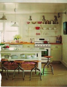 Interesting mix of farmhouse and 20th century industrial styles in a kitchen.