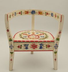 Norwegian Os style rosmaling on chair    It is in the collection at Vesterheim museum, and is Per Lysne 3 legged chair