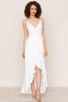 2a245d549a23b3 Meet the classic wrap silhouette of our Cross Roads White High Low Dress.  Details include self tie waist and snap chest closure.