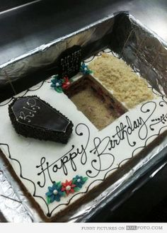Coffin cake - Funny cake with coffin and grave as a black humor joke for happy birthday.