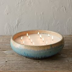 """An attention-grabbing way to illuminate outdoor gatherings while keeping bugs away, this multi-wicked, citronella candle pairs six pounds of hand-poured wax with a reusable, glazed ceramic bowl. Refreshingly scented, notes of feathery coconut pair with sweet vanilla, enticing fruit nectars, and a hint of citrus.- Soy blend wax, ceramic bowl- 12 cotton wicks- 55 hour burn time- Scent: Citronella- Hand-poured in the USA4""""H, 12"""" diameter"""