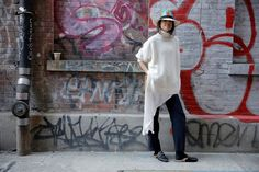 Straw hats and cashmere? Sounds like winter us. Leandra Medine of The Man Repeller wears Tibi's Cashmere Turtleneck sweater.