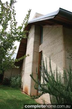 The exterior of a rammed earth home.