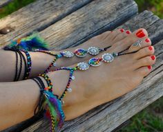 This listing is for a PAIR of barefoot sandals and ONE toe ring.  The black leather sandals (picture 3) are also available in the shop: https://www.etsy.com/listing/248578525/blak-suede-leather-sandals-fringe-hippie?ref=listing-shop-header-0  Beautiful and unique barefoot sandals with a tribal vibration. They look great as necklace or on the hands too :)  Handmade crocheted with love and care using waxed polyester cord, tibetan silver flower connectors, tibetan silver spiral charms, glass…