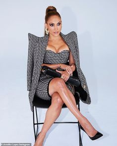So chic:The Bronx native made the most of the beige and black patterned dress that had a ...