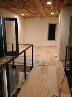 Plywood Flooring Installation | urban home INDY -Also love the 2x4 ceiling w/ the plywood floor