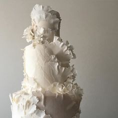 I knew @jubileelau would display this cake in the middle of the room...therefore this frilly lady could not have a backside...however, picking the front to greet guests as they entered was a subjective process... #sanfrancisco #weddingcake #tornpapereffect #texturejunkie #white #grey #neutral #handmadeflowers #sugarflowers #weddinginspiration #weddingcakedesign #artcake