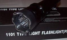 new 1101 Tourch Police Self-defense Electric Shock LED Flashligh....