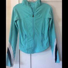 Lululemon Aqua Jacket Lululemon Aqua jacket size 4 with black and white detail on sleeves. Thumb holes and hood. This is gently worn and loved so the paint on the front zipper has chipped a tiny bit (see photo). Great fit! lululemon athletica Jackets & Coats