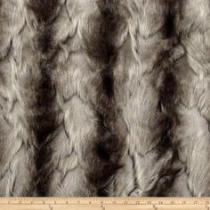 Faux Fur Brandy Fox Silver from @fabricdotcom  Spoil yourself with this exquisite long hair faux fabric. Fur has alternating 1/2'' to  1 1/2'' pile, a luxurious hand and a soft subtle sheen just like the real thing! Make gorgeous jackets, coats, wraps, fashion accessories, pillows, throws and more!