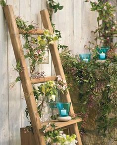 Old wooden ladder turned into a shelf for plants and knick knacks. I would love this on my lanai