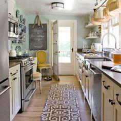 Cute. http://hookedonhouses.net/top-20/ blue wall, black counter, chalkboard, rug, stainless