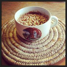 Porridge with Sunwheel pear & apple spread and chopped hazelnuts, served in Lourdes mug for added wholesomeness.