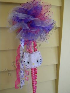 I made these tulle wands with felt hello kitty double sided wands for my 3 year old's birthday party. I made the korker ribbons too :) All the kids LOVED the wands to take home. An easy activity and they looked professional :)