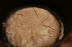Artisanal Homemade sourdough bread baked in iron cast casserole.  Step2