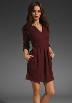 Believe it or not. This cranberry/maroon color goes with just about everything. Black, white, stripes, denim, navy blue. Can be paired with a number of different outfits. A closet must for me!