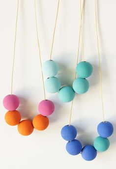 DIY Wood Bead Necklace: Make your own necklace with unfinished wood beads, paint, and cotton canvas cord. Want all the supplies in one box? Click the picture to visit Paste Supply Company.