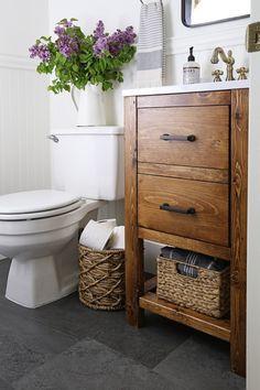 A small bathroom is made over into a classic, modern rustic bathroom on a budget! This small bathroom makeover used lots of budget-friendly DIY projects to transform a half bathroom! Diy Bathroom Vanity, Rustic Bathroom Vanities, Rustic Bathroom Decor, Budget Bathroom, Bathroom Ideas, Bathroom Organization, Bathroom Renovations, Bathroom Storage, Bathroom Designs