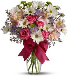 Looking for the prettiest bouquet in town? We've got the perfect all-around choice – a mix of blooms in breezy shades of pink, white, lavender and more, all tied up with a big pink bow! A great way to make someone smile
