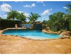 Gorgeous pool with stone work and #waterfall. MLS ID#: A1619563 - Single Family Home Real Estate | Boynton Beach, FL 33437