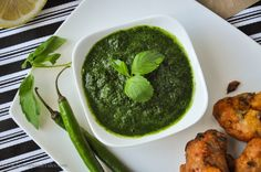 Mint and Coriander Chutney -- A delicious mixture of fresh herbs with the brightness of lemon and a hint of garlic! Perfect for dipping samosas and spicy Indian fritters! http://crumbsandtales.com/mint-and-coriander-chutney/