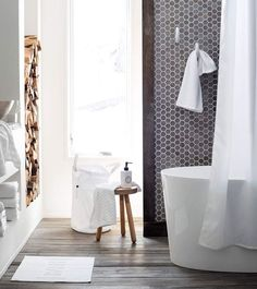 Wood flooring in the bath adds character and style, but if moisture is a concern, look for wood-look tile. Available in planks in many finishes - even reclaimed looks - they are easy to clean and maintain. Good advice from DesignMeetStyle.com