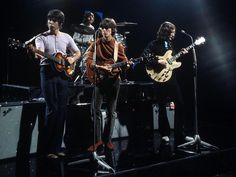 """The Beatles in their video for """"Revolution""""  Paul plays his original Hofner 5000A (which was stolen from the studio that very day) George plays a Gibson Les Paul Standard, and John Plays his refinished Epiphone Casino.  By this time, and until their breakup, Fender twin reverb amps were standard."""