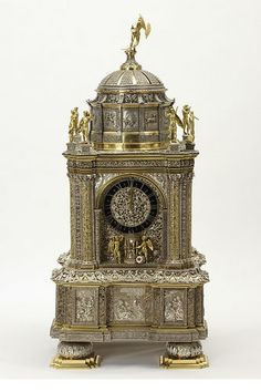 The case of this clock is by Hans Coenraadt Breghtel (1608-75) with movement by Adriaan van den Bergh. It is from the Hague in 1650-75 and is partially gilded silver. This clock was made for display as a masterpiece of design and technical virtuosity. The exceptionally fine goldsmiths' work includes richly embossed floral ornament and also silver filigree, a technique of Chinese origin.