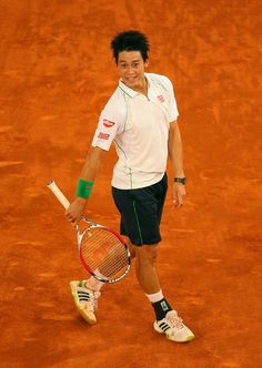 Kei Nishikori Photos - 2014 French Open - Day Two - Zimbio