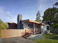"""""""The most challenging part of the design was fusing the old part of the house with the new addition,"""" says principal architect Alex Terry. The character and architectural integrity of the single-level 1950s ranch house was thoughtfully reconsidered during the addition and remodel. The home's front porch, typical of period, was refreshed with ipe decking and railing."""
