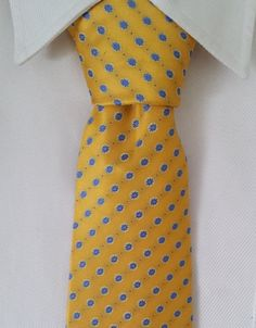 Yellow skinny tie with small floral polka dot pattern