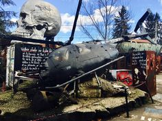 A wrecked helicopter and a cull at the entrance of the Abode of Chaos, a contemporary modern art museum in Lyon